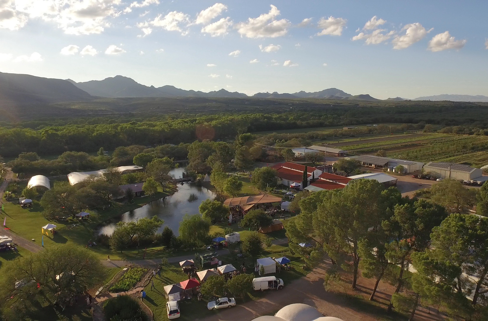An aerial shot of Avalon Organic Gardens & EcoVillage showing booths.