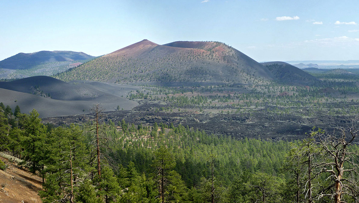 An ancient cinder cone stands dormant in Sunset Crater Volcano National Park.
