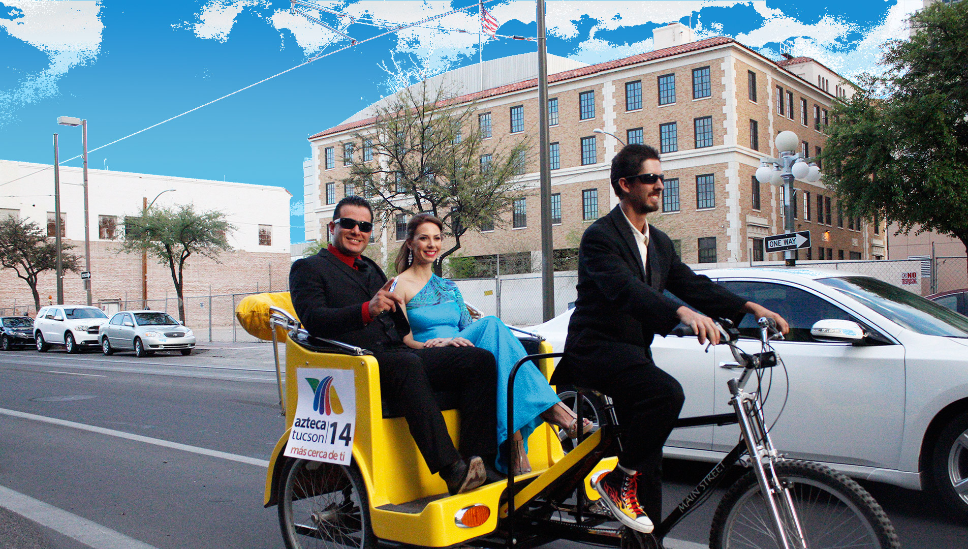 A young couple gets a ride through downtown Tucson on a pedicab.