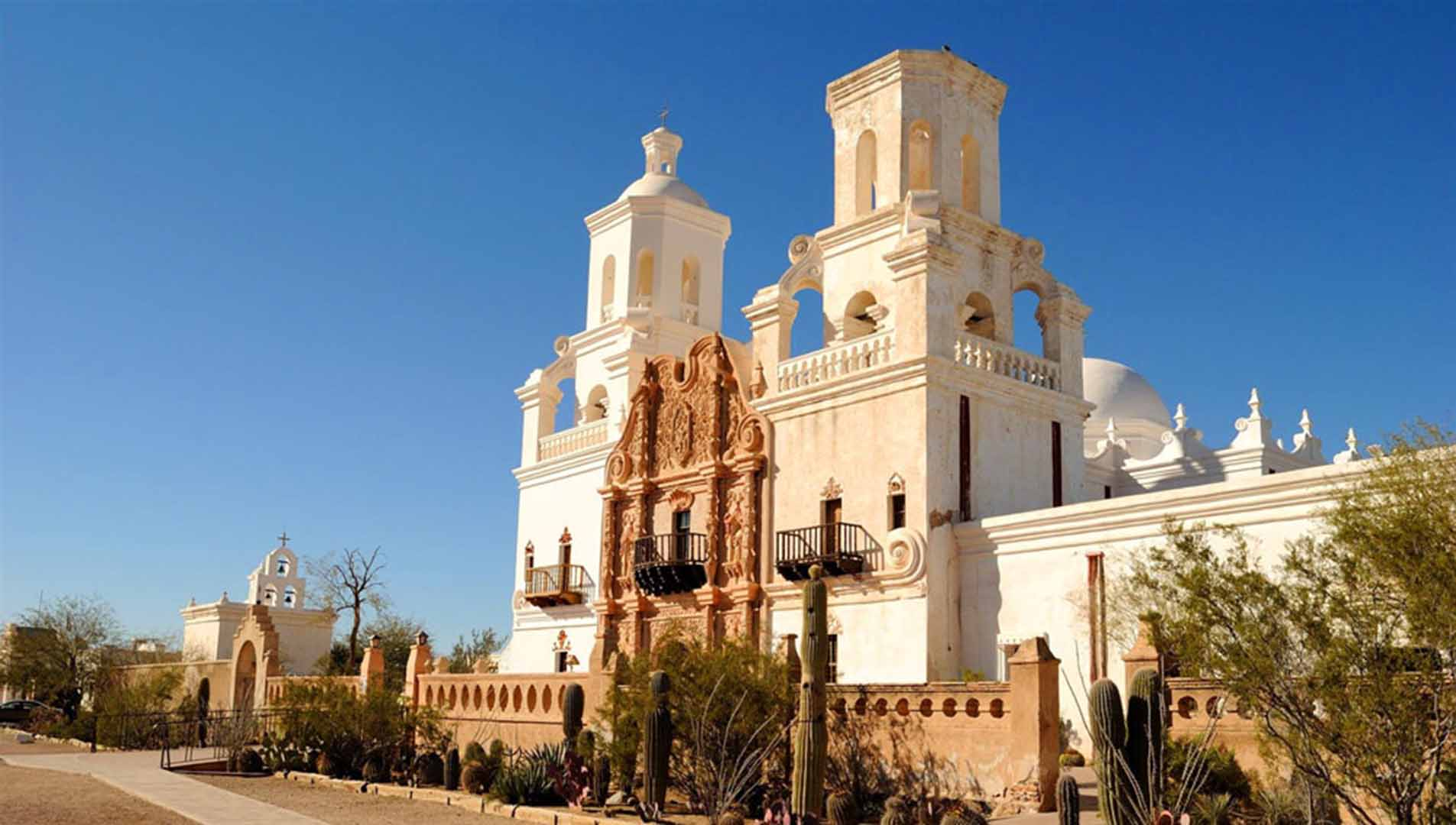 The mission San Xavier del Bac, the white dove of the desert. A preserved Spanish colonial chapel.