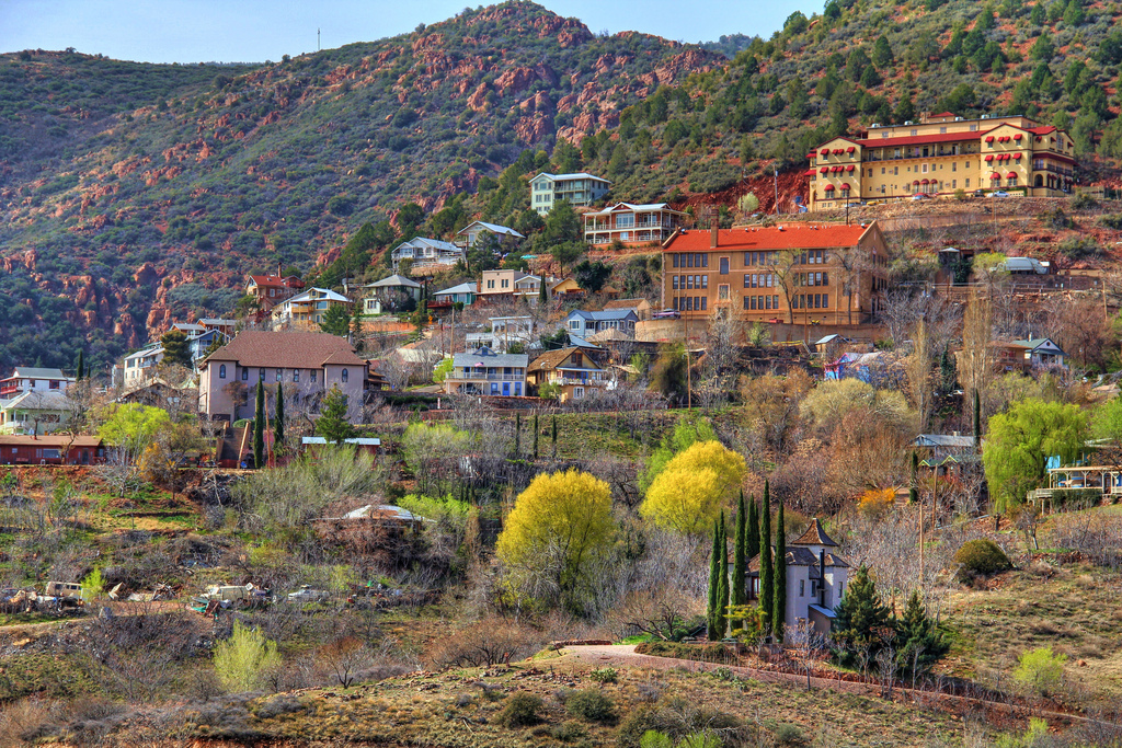 Colorful old buildings cling to the hillside in the mining ghost town of Jerome, Arizona.
